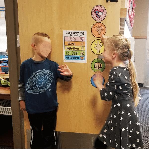 greeting students at door